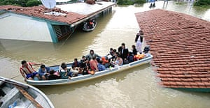 Residents of Villahermosa, the capital of the state of Tabasco, are rescued by the Mexican navy