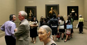Visitors look over paintings at an exhibit called 'The Age of Rembrandt: Dutch Paintings in the Metropolitan Museum of Art' at the Metropolitan Museum of Art in New York