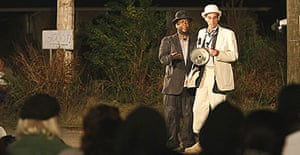 T Ryder Smith, as Pozzo, right, and Wendell Pierce, as Vladimir, in a free outdoor performance of Samuel Beckett's Waiting for Godot in the lower ninth ward, New Orleans.