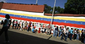 Line outside a state-run market in Caracas, Venezuela.