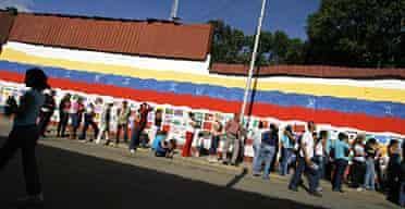 Line outside a state-run market in Caracas, Venezuela.