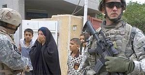 US troops talk to residents in Amiriya, a Sunni neighbourhood in west Baghdad