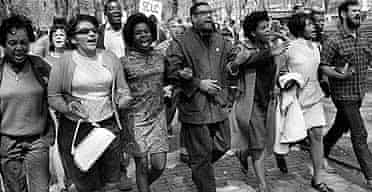 Arthur Fredericks, centre, leads singing marchers in Boston in the US for a civil rights rally in May 1968