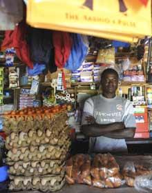 Katine - shopkeeper Simon Eebu