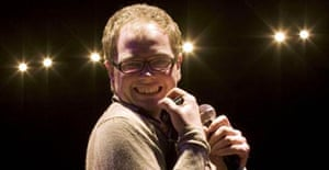Comedian Alan Carr on stage at Fairfield Hall, Croydon