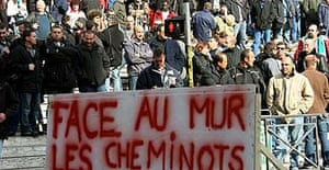 Train drivers protest in Marseille with a sign reading 'Facing the wall, the railway workers'