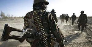 Afghan National Army soldiers head out on patrol.