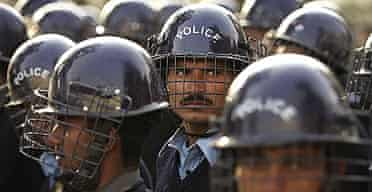 Pakistani riot police prepare for demonstrators rallying against President Pervez Musharraf at a road block in Islamabad.