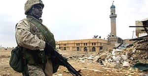 A US Marine patrols near a damaged mosque in Iraq