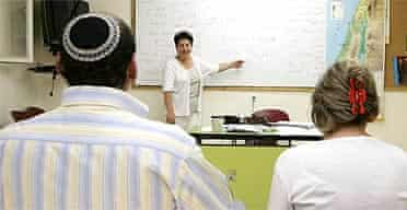 Newly arrived immigrants from Iran attend a Hebrew class at an absorption centre in Jerusalem