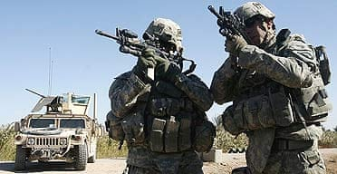 US soldiers look through scopes on their rifles during a patrol mission in the town of Yussifiyah, 12 miles south of Baghdad.