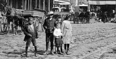 Children stand along a carriage track in New Orleans, circa 1895. Photograph: PL Sperr/Hulton Archive