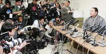 Sumo grand champion Asashoryu Akinori speaks at a news conference in Tokyo to announce his return