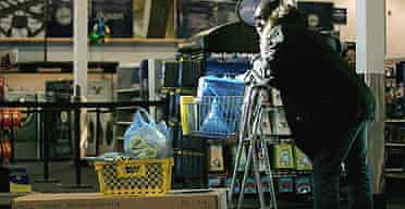 A shopper stands with a cart at a Best Buy store in Watertown, Massachusetts.