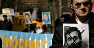 A protester holds a picture of Mahmoud Ahmadinejad at an Iranian-American rally in New York where Iran's nuclear activities were denounced. Photograph: Spencer Platt/Getty Images