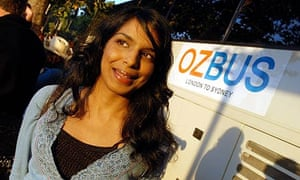 The writer Anita Sethi standing by the OzBus in London