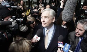 Former newspaper baron Conrad Black leaves the federal building in Chicago after sentencing in his racketeering and fraud trial