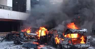 Cars burn at the scene of the bomb attack that killed Francois Hajj