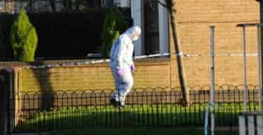 A police forensic officer in Farleigh Road, Stoke Newington, north London where a youth was stabbed to death in a mass brawl