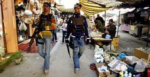 Sunni Arab 'sahwa' volunteers on patrol in Baghdad