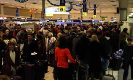 Passengers queue in Heathrow Airport's Terminal 1