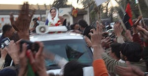 Benazir Bhutto waves from her car just seconds before being assassinated in a bomb attack following a political rally in Rawalpindi, Pakistan.
