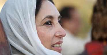 Former Pakistani Prime Minister Benazir Bhutto gazes towards a crowd of thousands of supporters at a campaign rally minutes before she was assassinated in a bomb attack December 27, 2007 in Rawalpindi, Pakistan