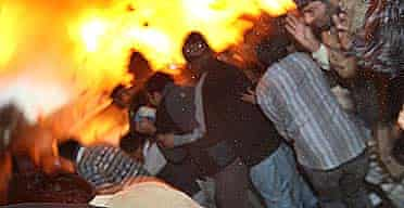 A bomb explodes next to the vehicle of Benazir Bhutto