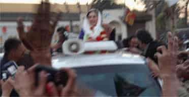 Benazir Bhutto seconds before she was shot and a suicide bomb went off