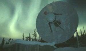 Aurora borealis over a satellite antenna at EsrangeSpaceCenter