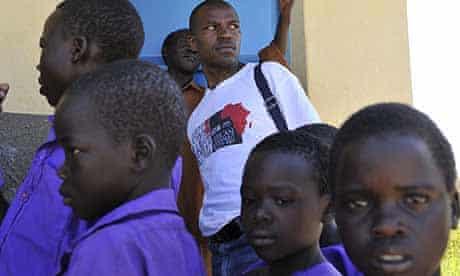 Katine: Weekly Observer reporter Richard Kavuma at the Ojago community primary school