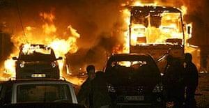 A car and a bus burn after an explosion in Diyarbakir, south eastern Turkey
