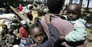 Displaced people gather outside an airforce base in the Mathare slum in Nairobi, Kenya