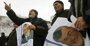 Supporters of Levan Gachechiladze shout during a rally