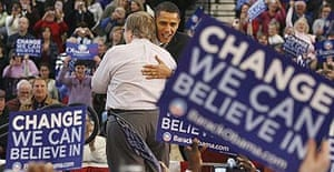 Barack Obama hugs a supporter during a campaign rally at Nashua North high school in New Hampshire.