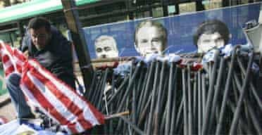 A Jerusalem municipal worker hangs a US flag