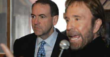 Chuck Norris addresses a New Hampshire crowd as Mike Huckabee looks on