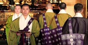 Buddhist monks take to the catwalk at the Tsukiji Honganji temple in Tokyo last month. The event opened with the recital of a prayer set to a hip-hop beat