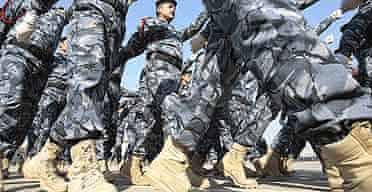 Commandos parade during a ceremony marking Iraqi police forces 86th anniversary in Baghdad.