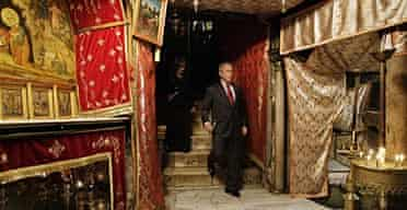 George Bush visits the Grotto of the Nativity.