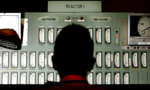 A power station worker monitors one of the reactors in the control room of Oldbury nuclear power station