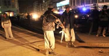 Police guard the Serena hotel in Kabul