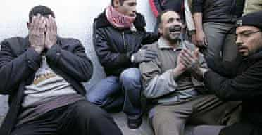 Palestinian relatives of a Hamas militant mourn his death in Gaza