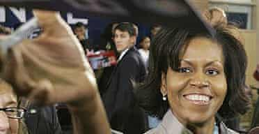 Michelle Obama signs autographs after a town hall meeting in Las Vegas.