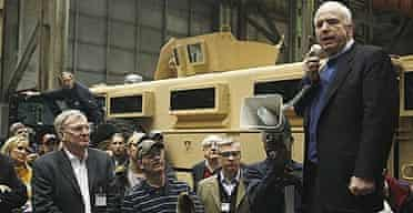 John McCain addresses workers during a visit to Force Protection, Inc, which produces armoured vehicles, in Charleston, South Carolina.