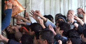 Palestinians try to buy bread from a bakery in Gaza City during Israel's blockade of fuel