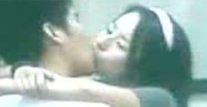 Chinese couple kissing on subway