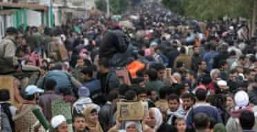 Palestinians crowd a street on the Egyptian side of Rafah