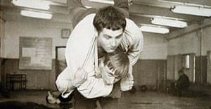 A young Vladimir Putin (below) during a training fight with fellow pupil Vassily Shestakov at a St Petersburg sports school's judo class in 1971