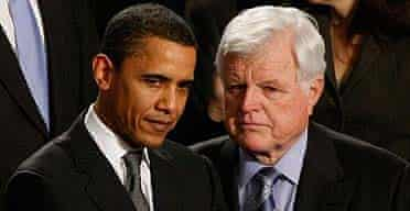 Barack Obama stands next to Senator Edward Kennedy at the State of the Union speech by president George Bush